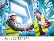 Купить «Oil refinery engineers successful deal handshake.», фото № 28137247, снято 19 сентября 2018 г. (c) easy Fotostock / Фотобанк Лори