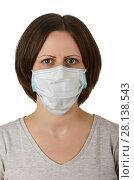 Купить «Woman in disposable medical protective mask isolated on white», фото № 28138543, снято 30 апреля 2017 г. (c) Сергей Молодиков / Фотобанк Лори