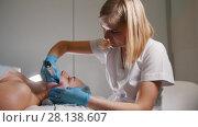 Купить «Scina care - pilling of face - professional cosmetic procedure - mask facial massage at spa salon skincare», видеоролик № 28138607, снято 22 августа 2018 г. (c) Константин Шишкин / Фотобанк Лори
