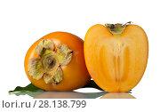 Купить «Whole orange persimmon and half of fruit isolated on white», фото № 28138799, снято 20 декабря 2017 г. (c) Сергей Молодиков / Фотобанк Лори