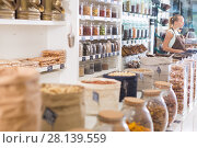 Купить «Photo of bags with dried fruits and nuts», фото № 28139559, снято 4 сентября 2017 г. (c) Яков Филимонов / Фотобанк Лори