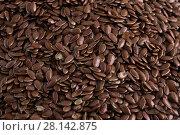 Купить «Фон: Семена льна», фото № 28142875, снято 23 февраля 2018 г. (c) Литвяк Игорь / Фотобанк Лори