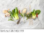 Купить «Salad Pak-choi (Chinese cabbage), rice and seasonings on a light old scratched table.», фото № 28143119, снято 4 февраля 2018 г. (c) Olesya Tseytlin / Фотобанк Лори