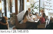 Купить «Four attractive women having lunch and discussing», видеоролик № 28145815, снято 30 января 2018 г. (c) Виктор Аллин / Фотобанк Лори