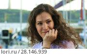 Купить «Portrait of pretty brunette smiling and posing at camera outdoor», видеоролик № 28146939, снято 10 июня 2017 г. (c) Алексей Кузнецов / Фотобанк Лори