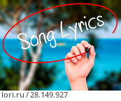 Купить «Man Hand writing Song Lyrics with black marker on visual screen», фото № 28149927, снято 21 июля 2018 г. (c) easy Fotostock / Фотобанк Лори