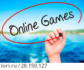 Купить «Man Hand writing Online Games with black marker on visual screen», фото № 28150127, снято 21 июля 2018 г. (c) easy Fotostock / Фотобанк Лори