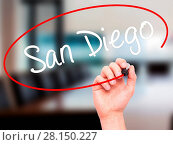 Купить «Man Hand writing San Diego with black marker on visual screen», фото № 28150227, снято 21 июля 2018 г. (c) easy Fotostock / Фотобанк Лори