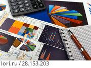 Купить «Калькулятор, графики и диаграммы. Бизнес-натюрморт», эксклюзивное фото № 28153203, снято 11 марта 2018 г. (c) Юрий Морозов / Фотобанк Лори