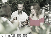 Купить «Young friends are playful talking in time lunch», фото № 28153555, снято 18 октября 2017 г. (c) Яков Филимонов / Фотобанк Лори