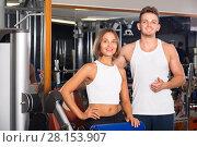 Купить «man and woman fitness coaches in gym», фото № 28153907, снято 4 октября 2016 г. (c) Яков Филимонов / Фотобанк Лори