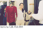 Купить «Family choosing dress and blouse at clothing shop», фото № 28153991, снято 24 октября 2016 г. (c) Яков Филимонов / Фотобанк Лори
