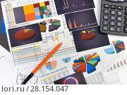 Купить «Калькулятор, таблицы, графики и диаграммы. Бизнес-натюрморт», эксклюзивное фото № 28154047, снято 11 марта 2018 г. (c) Юрий Морозов / Фотобанк Лори