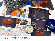 Купить «Калькулятор, таблицы, графики и диаграммы. Бизнес-натюрморт», эксклюзивное фото № 28154055, снято 11 марта 2018 г. (c) Юрий Морозов / Фотобанк Лори