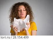 Купить «woman furiously tore the paper», фото № 28154499, снято 29 января 2018 г. (c) Типляшина Евгения / Фотобанк Лори