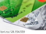 Купить «Кредитные карточки на светлом фоне. Крупный план», эксклюзивное фото № 28154559, снято 5 марта 2018 г. (c) Игорь Низов / Фотобанк Лори