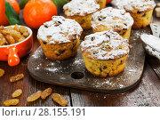 Купить «Mandarin muffins with raisins on the table», фото № 28155191, снято 6 января 2018 г. (c) Надежда Мишкова / Фотобанк Лори