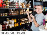 Купить «Senior man buyer choosing products in grocery», фото № 28156203, снято 5 октября 2016 г. (c) Яков Филимонов / Фотобанк Лори