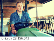 Купить «Portrait of male farmer in the special car», фото № 28156343, снято 24 октября 2017 г. (c) Яков Филимонов / Фотобанк Лори