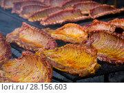 Купить «Meat ribs of pig roasting on barbecue», фото № 28156603, снято 30 апреля 2017 г. (c) Яков Филимонов / Фотобанк Лори