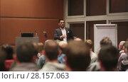 Купить «Public speaker giving talk at business event», видеоролик № 28157063, снято 5 апреля 2020 г. (c) Matej Kastelic / Фотобанк Лори