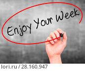 Купить «Man Hand writing Enjoy Your Week with black marker on visual screen», фото № 28160947, снято 29 мая 2020 г. (c) easy Fotostock / Фотобанк Лори