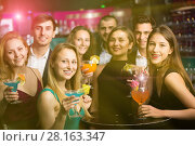 Купить «Laughing colleagues dancing on corporate party», фото № 28163347, снято 20 апреля 2017 г. (c) Яков Филимонов / Фотобанк Лори