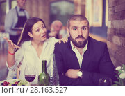 Купить «quarreled visitors female and male in restaurant», фото № 28163527, снято 11 декабря 2017 г. (c) Яков Филимонов / Фотобанк Лори