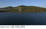 Купить «Drone flying from sea to the shore with houses on waterfront, Greece», видеоролик № 28164259, снято 4 марта 2018 г. (c) Данил Руденко / Фотобанк Лори