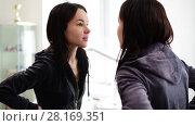 Купить «young beautiful girl looks at herself in mirror», видеоролик № 28169351, снято 14 марта 2018 г. (c) Володина Ольга / Фотобанк Лори