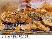 Купить «Baked goods on wicker mat», фото № 28170135, снято 30 января 2018 г. (c) Яков Филимонов / Фотобанк Лори