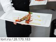 Cooked tiger shrimp oт plate in male hands. Стоковое фото, фотограф Яков Филимонов / Фотобанк Лори