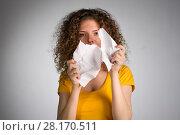Купить «woman furiously tore the paper», фото № 28170511, снято 29 января 2018 г. (c) Типляшина Евгения / Фотобанк Лори