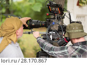 RUSSIA, MOSCOW – 30 JUL, 2015: Men are shooting movie (Maximum shock) with professional digital video camera in the Sokolniki park. Редакционное фото, фотограф Losevsky Pavel / Фотобанк Лори