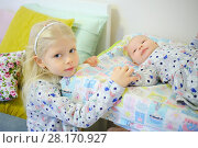 Купить «Little girl and her baby sister in same dresses in bedroom of home», фото № 28170927, снято 25 октября 2016 г. (c) Losevsky Pavel / Фотобанк Лори