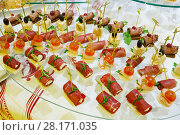 Купить «Many canapes - cold appetizers are on table with white cloth», фото № 28171035, снято 25 октября 2016 г. (c) Losevsky Pavel / Фотобанк Лори