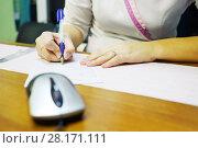 Купить «Hands of woman doctor writing description of ECG on wooden table», фото № 28171111, снято 20 ноября 2015 г. (c) Losevsky Pavel / Фотобанк Лори