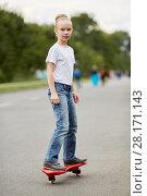 Купить «Girl rides two-wheeled skateboard on street», фото № 28171143, снято 10 сентября 2016 г. (c) Losevsky Pavel / Фотобанк Лори