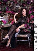 Купить «Curly woman in transparent dress sits near piano among flowers in stylish studio», фото № 28171191, снято 27 ноября 2015 г. (c) Losevsky Pavel / Фотобанк Лори