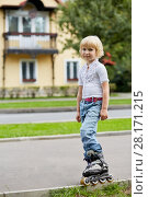 Купить «Little blonde girl on roller skate on street in front of house», фото № 28171215, снято 10 сентября 2016 г. (c) Losevsky Pavel / Фотобанк Лори