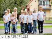 Купить «Group portrait of woman and nine children outdoors against two-storied house», фото № 28171223, снято 10 сентября 2016 г. (c) Losevsky Pavel / Фотобанк Лори