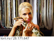 Купить «Blonde beautiful woman poses with big snake in room, shallow dof», фото № 28171647, снято 18 июля 2016 г. (c) Losevsky Pavel / Фотобанк Лори