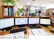 Купить «MOSCOW, RUSSIA - APR 25, 2016: Workplace with four monitors and many documents in Moscow city telephone network», фото № 28171651, снято 25 апреля 2016 г. (c) Losevsky Pavel / Фотобанк Лори