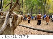 Купить «Stuffed deer and people in national costumes of Chukchi out of focus in fall forest», фото № 28171719, снято 18 октября 2015 г. (c) Losevsky Pavel / Фотобанк Лори