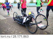 Купить «MOSCOW - SEP 25, 2016: Disabled man in wheelchair during Promsvyazbank Moscow marathon amateurs and professionals again ran 42.2 km on central streets and quays of Moscow», фото № 28171863, снято 25 сентября 2016 г. (c) Losevsky Pavel / Фотобанк Лори