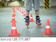 Купить «Legs of roller skater standing on floor near orange cones in indoor parking», фото № 28171887, снято 22 октября 2015 г. (c) Losevsky Pavel / Фотобанк Лори