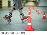 Купить «Legs of roller skater posing on floor near orange cones in indoor parking», фото № 28171895, снято 22 октября 2015 г. (c) Losevsky Pavel / Фотобанк Лори