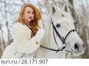 Купить «Young woman in white dress and white fur mantle strokes white horse in park», фото № 28171907, снято 15 января 2016 г. (c) Losevsky Pavel / Фотобанк Лори