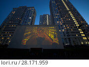 MOSCOW, RUSSIA - MAY 25, 2016: Translaion of children cartoons onto the big screen from notebook in the yard of a residential complex of Elk Island. Редакционное фото, фотограф Losevsky Pavel / Фотобанк Лори