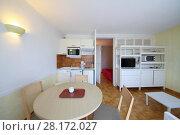 Купить «White lit kitchen with tv, refrigerator, microwave in modern hotel», фото № 28172027, снято 26 июля 2016 г. (c) Losevsky Pavel / Фотобанк Лори